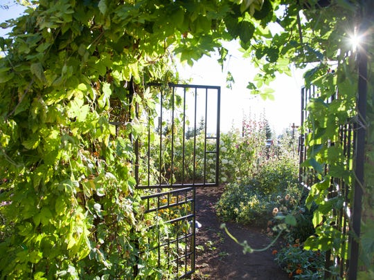 The entrance into Frank and Christine Golden's large fenced garden.