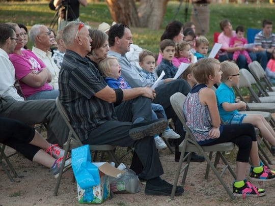 Members of the local community gather at Cottonwood
