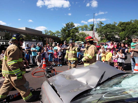Firefighters use the Jaws of Life during an extrication