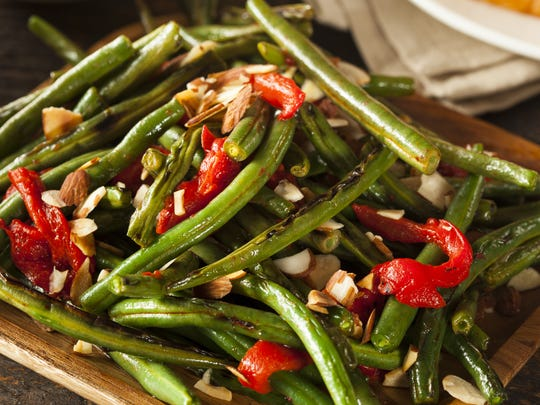 Green beans with red bell pepper and slivered almonds.