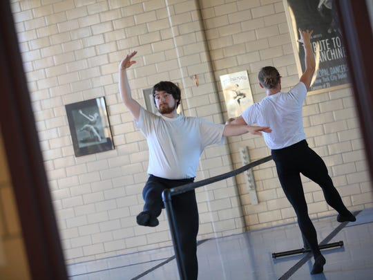 Austin Kelly practices ballet at Flower City Ballet, located on Cumberland Street in Rochester.