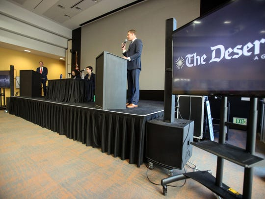 California 42nd Assembly District representative Chad Mayes, right, speaks as his challenger Greg Rodriguez looks on during a debate moderated by The Desert Sun