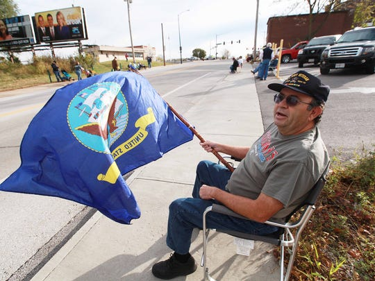Thousands attended and participated in the Veterans Day Parade in Springfield, MO on Sat. Nov. 5, 2016.Scott Kelley, a Navy veteran, flies his Navy flag.