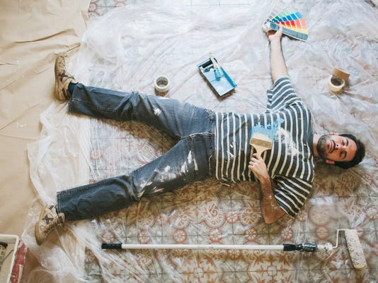Exhausted man resting after hard painting work