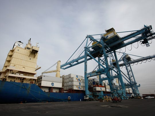 Chiquita shipping containers are loaded and unloaded