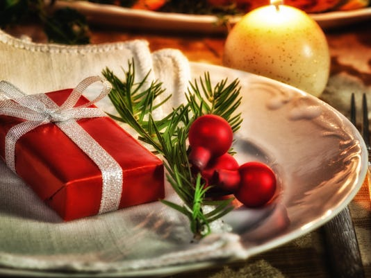 Christmas place setting with gift in a plate