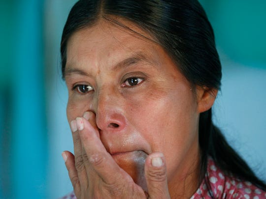 In this July 15, 2016 photo, Maria Felix Martinez Chavez wipes away tears during an interview inside the bedroom her family built for her late son, Jose Chavez, using money he sent home from the U.S. earned while part of a guest workers program, in El Sabino, Mexico. The room was meant to be a surprise for him. The family's main bread winner died in a bus accident in the U.S. when returning home to Mexico.