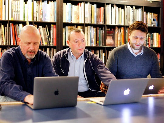 From left, Code for Asheville co-captain Eric Jackson, core team member Patrick Conant and co-captain Jesse Michel meet at Battery Park Book Exchange & Champagne Bar December 20, 2016. From homelessness to race and policing, Code for Asheville has embarked on a path to help the most vulnerable in the past year, following a national Code for America trend and pursuing a mission to use technology to make the community better.