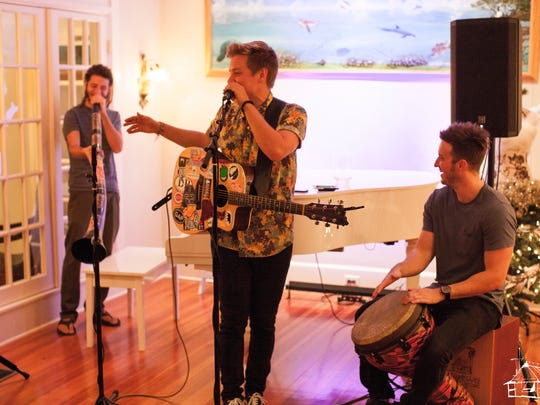 Matt Walden, a Clearwater based musician, performs with support by Justin Kaczmarek (left) and Eddie Kopp (right).