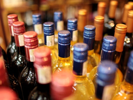 Rows of wine bottles with colorful tops