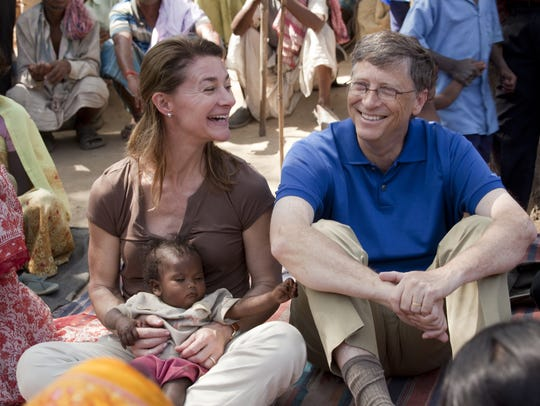 Bill and Melinda Gates meet with women in Jamsaut village