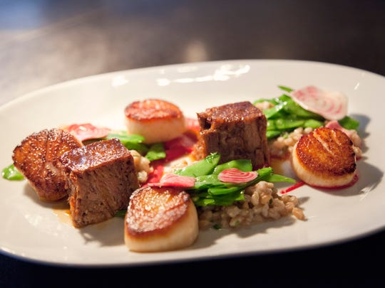 A dish at Ninety Acres of short rib and scallops served with fermented faro and snow peas and sugar snap peas.