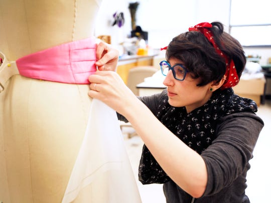 Carina Lopez, Asheville Community Theatre costume shop manager, pins fabric together as she creates a mermaid costume March 17, 2017 at UNC Asheville.