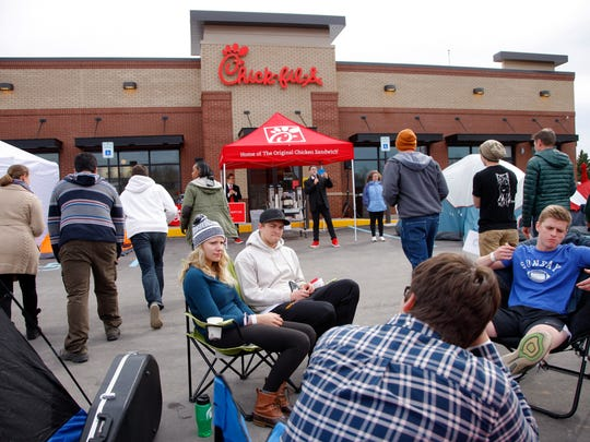 Chick-fil-A fans wait for the Chick-fil-A opening, Wednesday, March 29, 2017, in Okemos, Michigan.