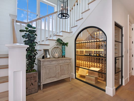 Tuck a wine closet under the staircase.