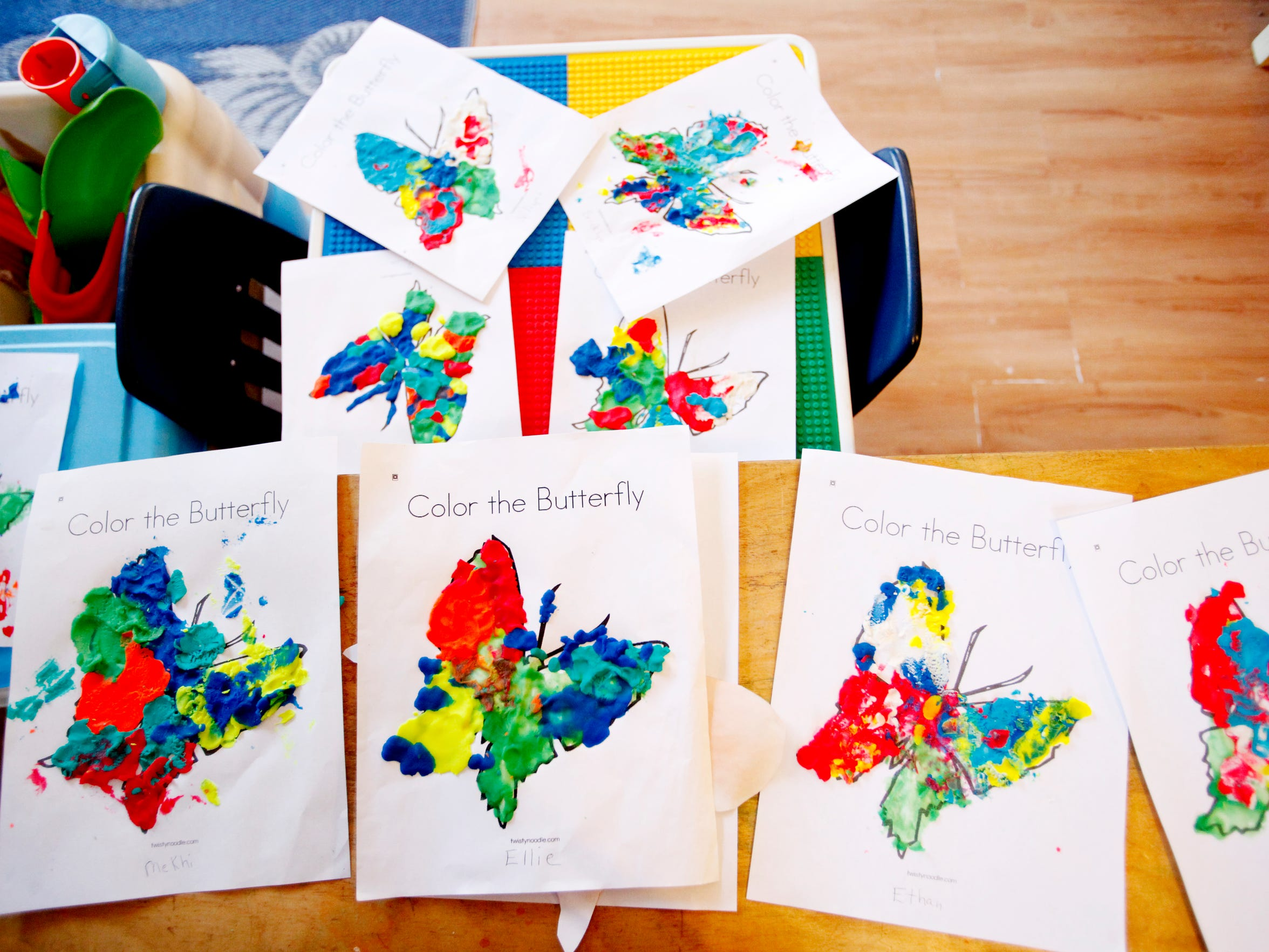 Butterflies that have been colored with modeling clay dry at Kathy's Kiddie Land March.