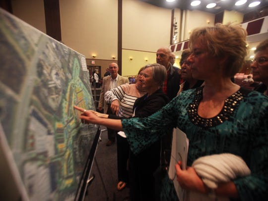 Residents review the plan to develop Brandywine Country