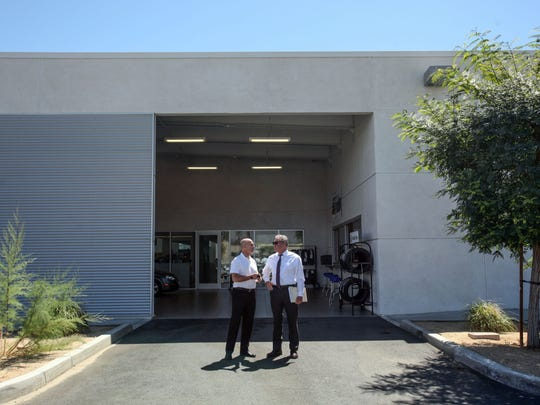 Andy Jessup Jr., right, president of Jessup Auto Plaza which includes Chevy, Buick, GMC and Cadillac, talks with Steve Hinkle, Vice President of Palm Springs Subaru, on Wednesday, April 5, 2017 in Cathedral City.