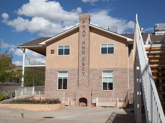 Members of the Creekers Foundation in Hildale tour