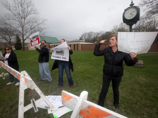 Luann Dinino, right and and other protestors from Save