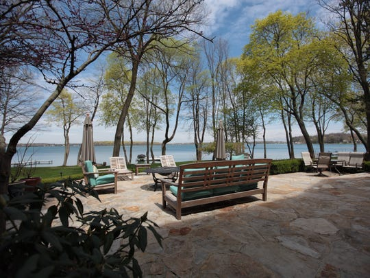 This gracious waterfront house has striking long views of Orchard Lake and Apple Island, big sunny spaces, a small beach of its own and two docks that mark off a sandy swimming area.