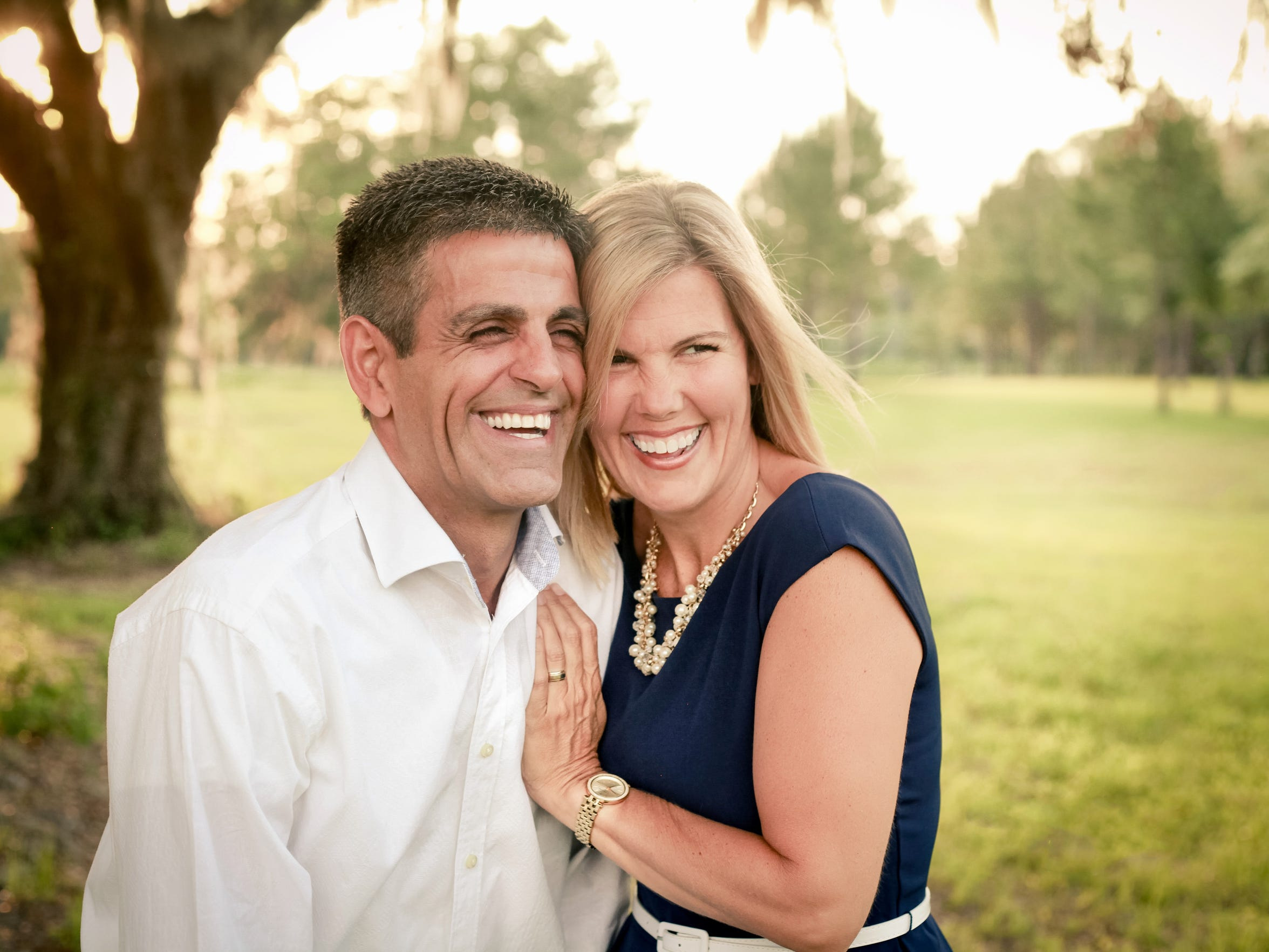 Rudy and Shelly Blanco pose during a family photo shoot before their son Noah's graduation from high school.