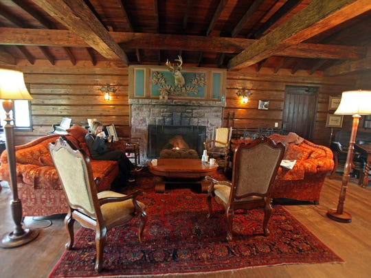 The great room at Stout's Island Lodge features a wood-burning fireplace.