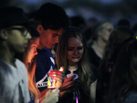 Students from Poudre High School mourn the loss of
