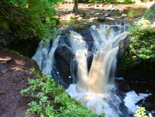 Snake Pit Falls plunges into a pool along the Amnicon