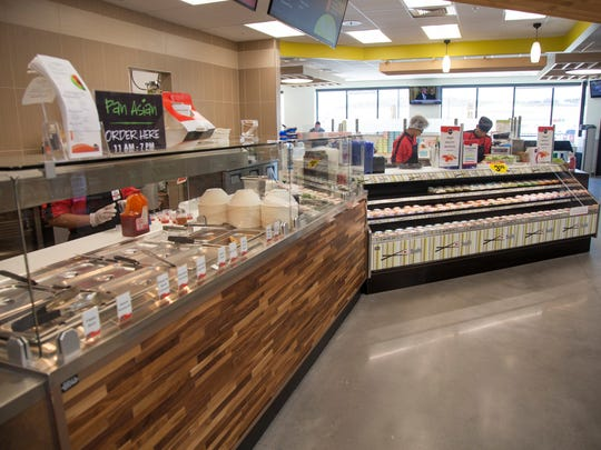 Employees at Smith's Marketplace at Dinosaur Crossing prepare for opening day Tuesday, Aug. 1, 2017. The 123,000 square foot store will add 257 new jobs to the area, and offer an assortment of groceries, apparel, housewares and small kitchen appliances.