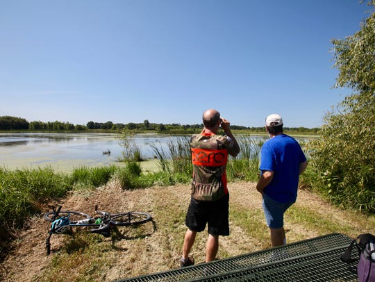 Mike Rhoades (left) and Paul Renaud look out over a