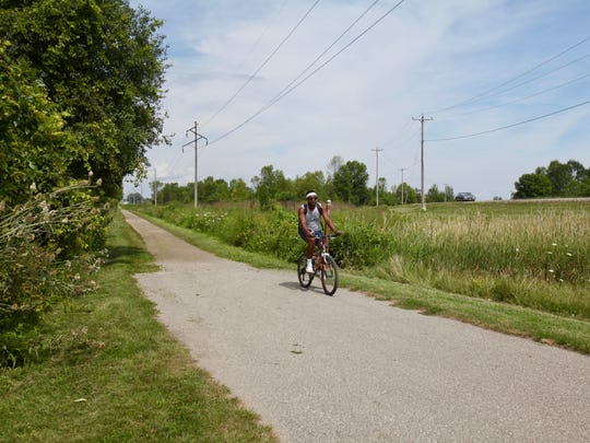 A cyclist rides on the Wiouwash State Trail outside