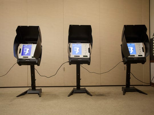 Voting machines sit lined up waiting for voters at the Washington City branch of the Washington County Library in this Spectrum file photo.