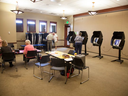 Residents cast their votes at the Washington Library