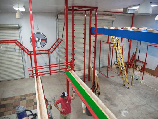 American Ninja Warrior contestants lead the construction of a new gym for athletes interested in learning obstacle courses, free running and similar sports Wednesday, Aug. 9, 2017.