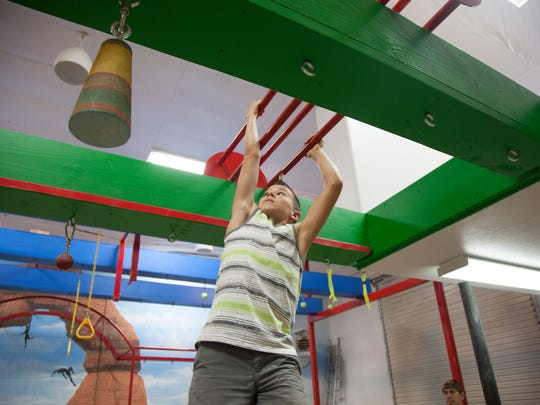 Kai Beckstrand demonstrates the rolling dice obstacle workout at The Grip, a new Washington City gym for athletes interested in developing strength based on the elements of the American Ninja Warrior TV show Wednesday, Aug. 9, 2017.