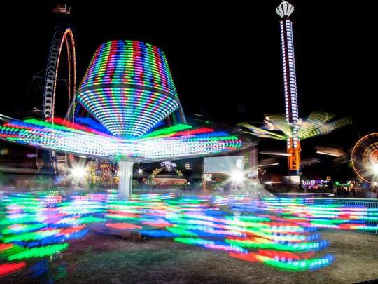 While you're at the fair, you can take a spin on a carnival ride.