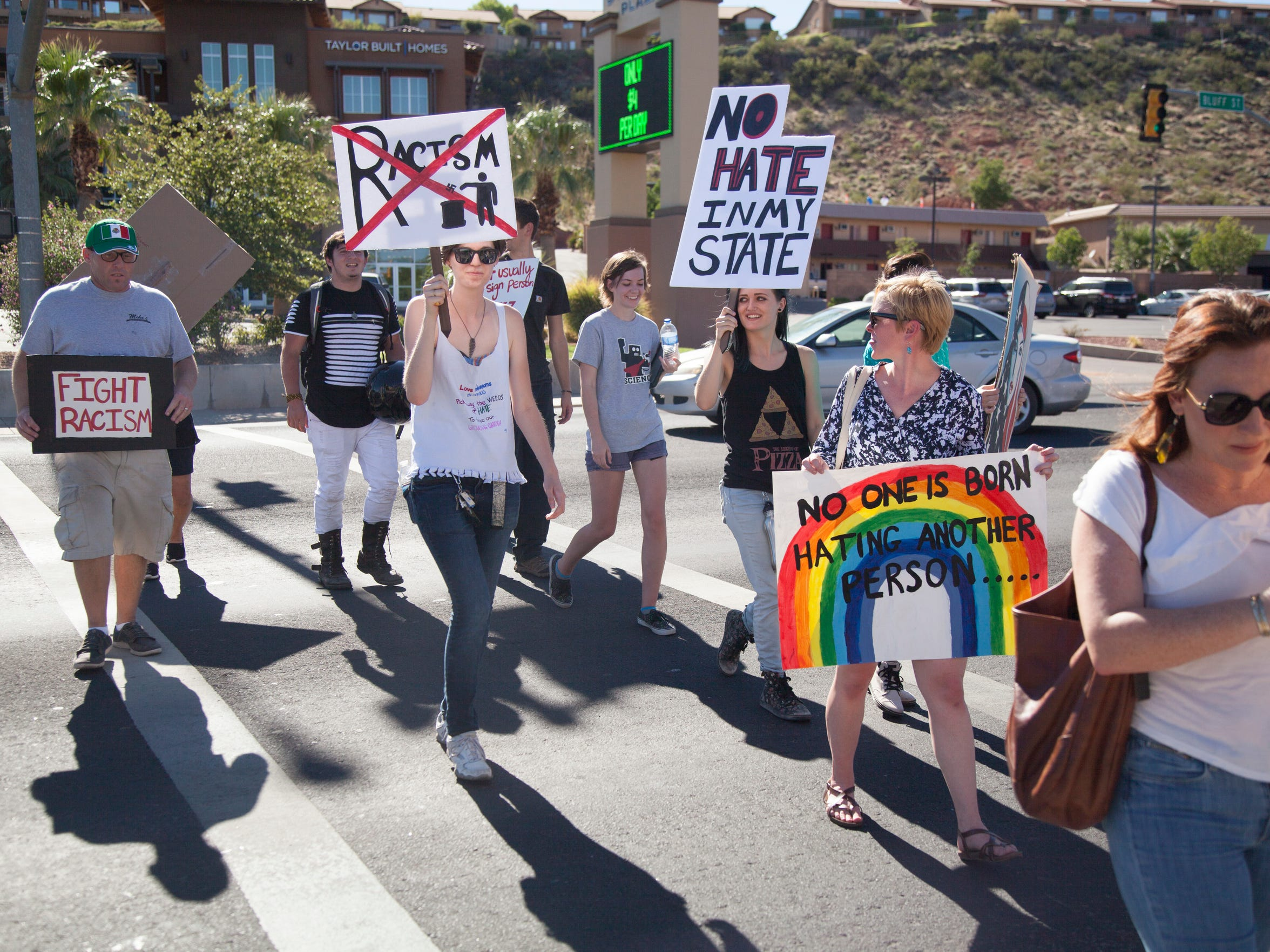 St. George residents march Bluff Street in solidarity with Charlottesville and to stand up against racism Saturday, Aug. 19, 2017.