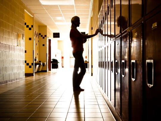Silhouette of student in hallway.
