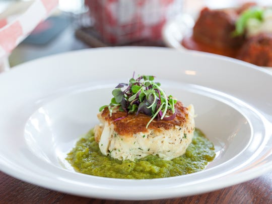A crab cake is made to order at Redz in Mount Laurel. The restaurant is known for its seafood, although there is plenty for other guests.