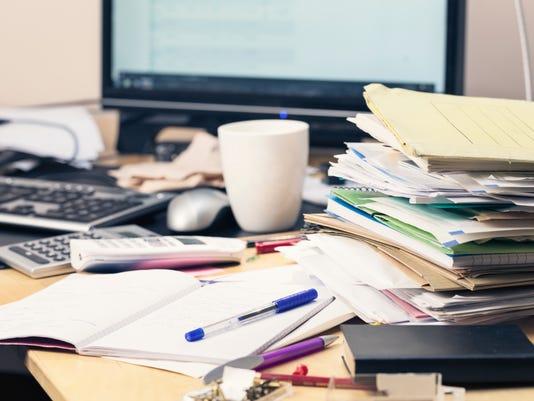 messy desk paperwork