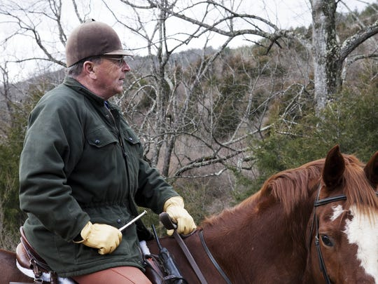 Middlebrook Hunt Club's huntsman Fred Getty sets off