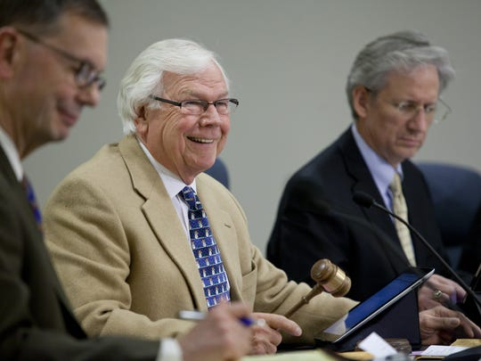 District 3 Commissioner Howard Heidemann speaks during a meeting in 2014 in between Commissioner Karl Tomion, right, and former administrator Bill Kauffman.