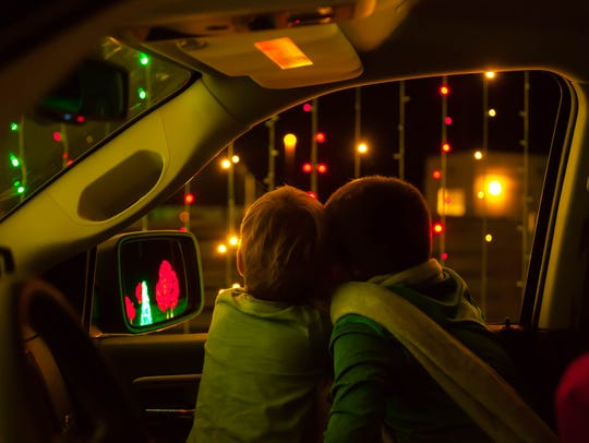 Passengers take in the view from their car at the 2017 Illumination Symphony of Light display at Interstate 17 and Jomax Road in north Phoenix.