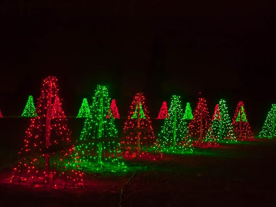 Red and green trees were part of 2017's Illumination Symphony of Light display.