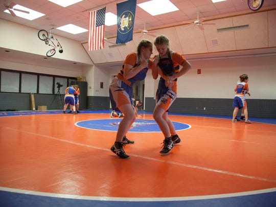 The Water Canyon High School wrestling team practices before their first match Wednesday, Nov. 29, 2017.