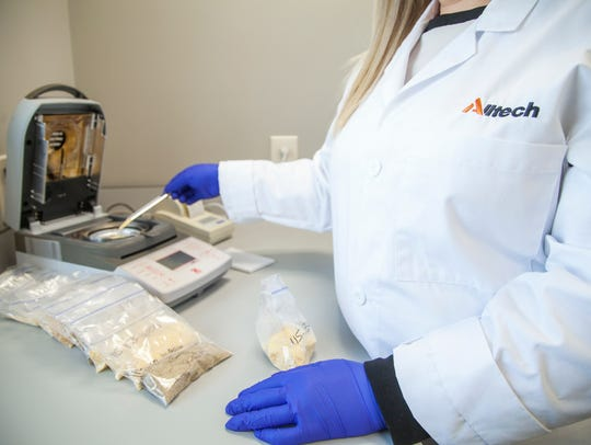 Feed sample testing in the 37+ lab at Alltech Headquarters