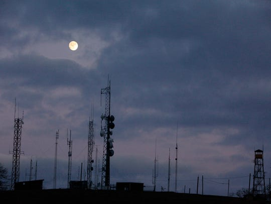 The moon rises over the towers on Bearwallow Mountain