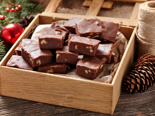 Christmas fudge on display in a wooden box.