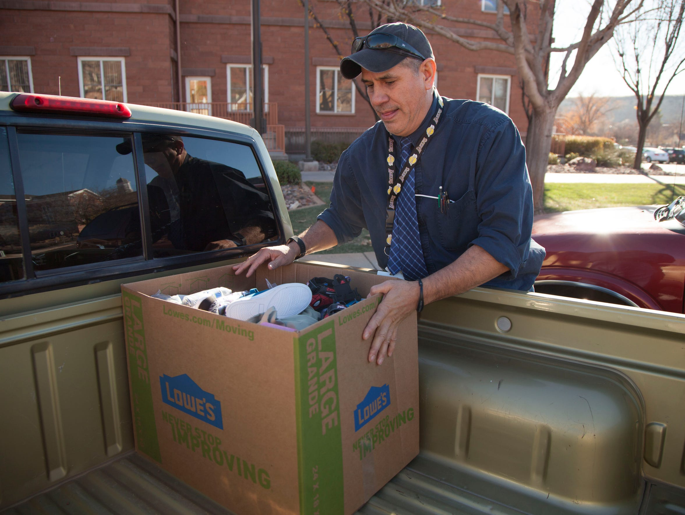 Glen Mesa, a Washington County School District counselor, receives donations from Step Up St. George to distribute to homeless families and students he serves at his schools.